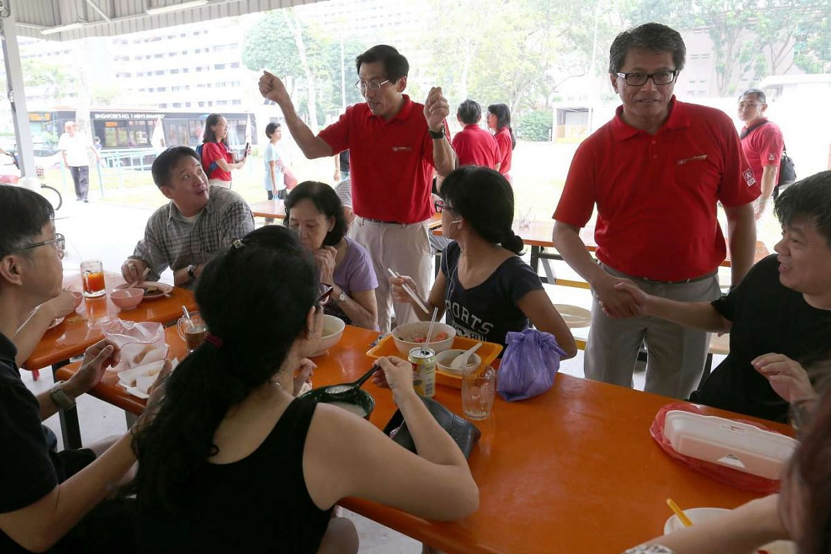 SDP candidates for Holland-Bukit Timah GRC Dr Chee Soon Juan and Sidek Mallek walkabout at Ghim Moh market and food centre.