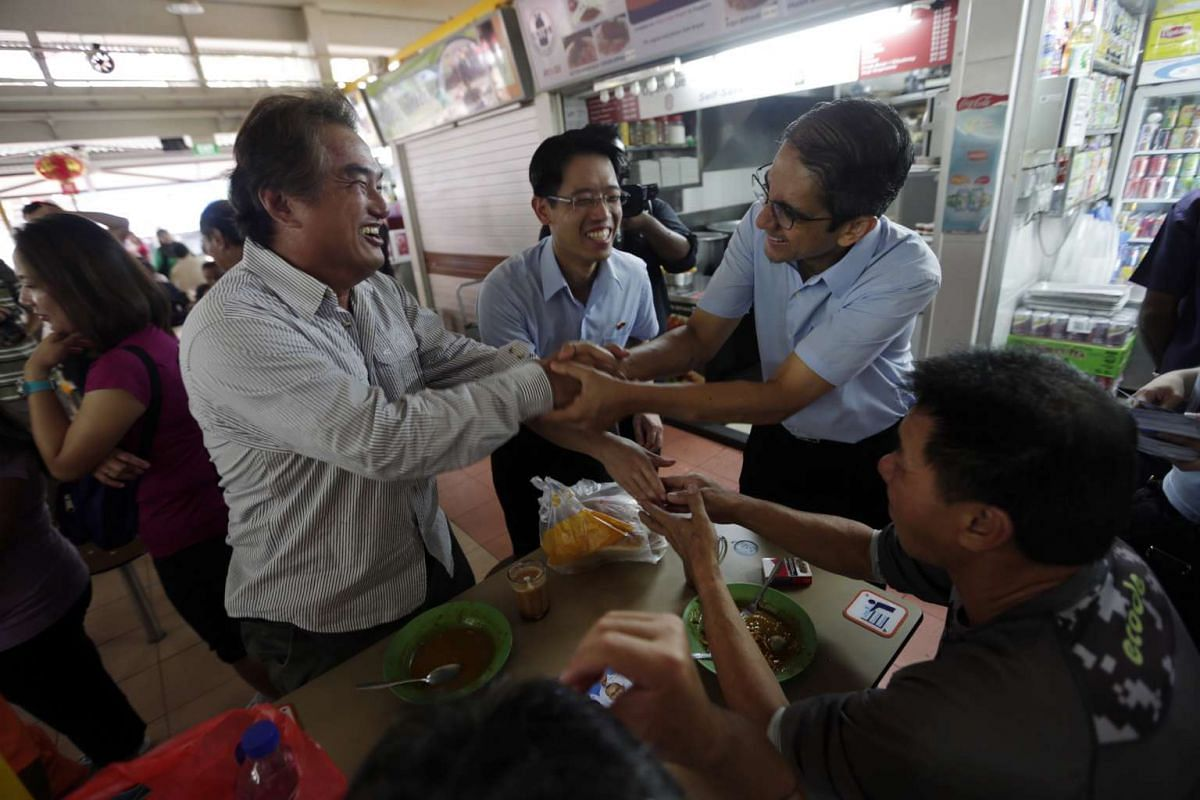 Workers' Party candidates for East Coast GRC - Gerald Giam, Daniel Goh, Fairoz Shariff, and Leon Perera - and candidate for Hougang SMC Png Eng Huat, go on a walkabout at Changi Village, Blk 3 Market and Hawker Centre at 3 Changi Village Road.
