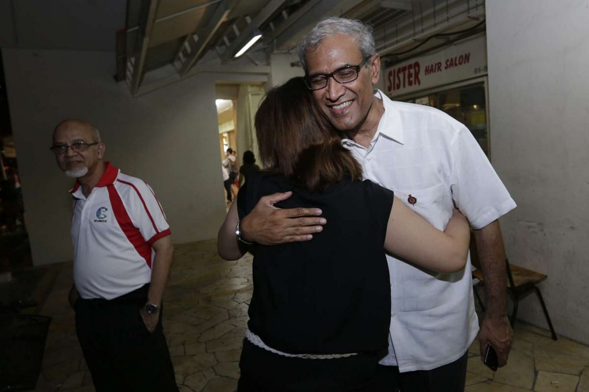 Former Member of Parliament for Aljunied GRC Zainal Abidin Rasheed (right) gets a hug from a resident at Blk 631 Bedok Reservoir Road.
