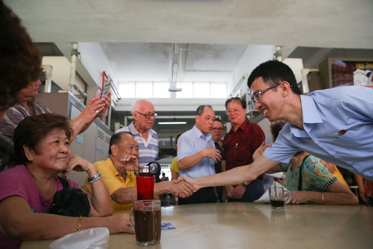 Workers' Party's Low Thia Khiang and Bernard Chen walkabout for MacPherson SMC outreach at Circuit Road Blk 89 Market and Food Centre.