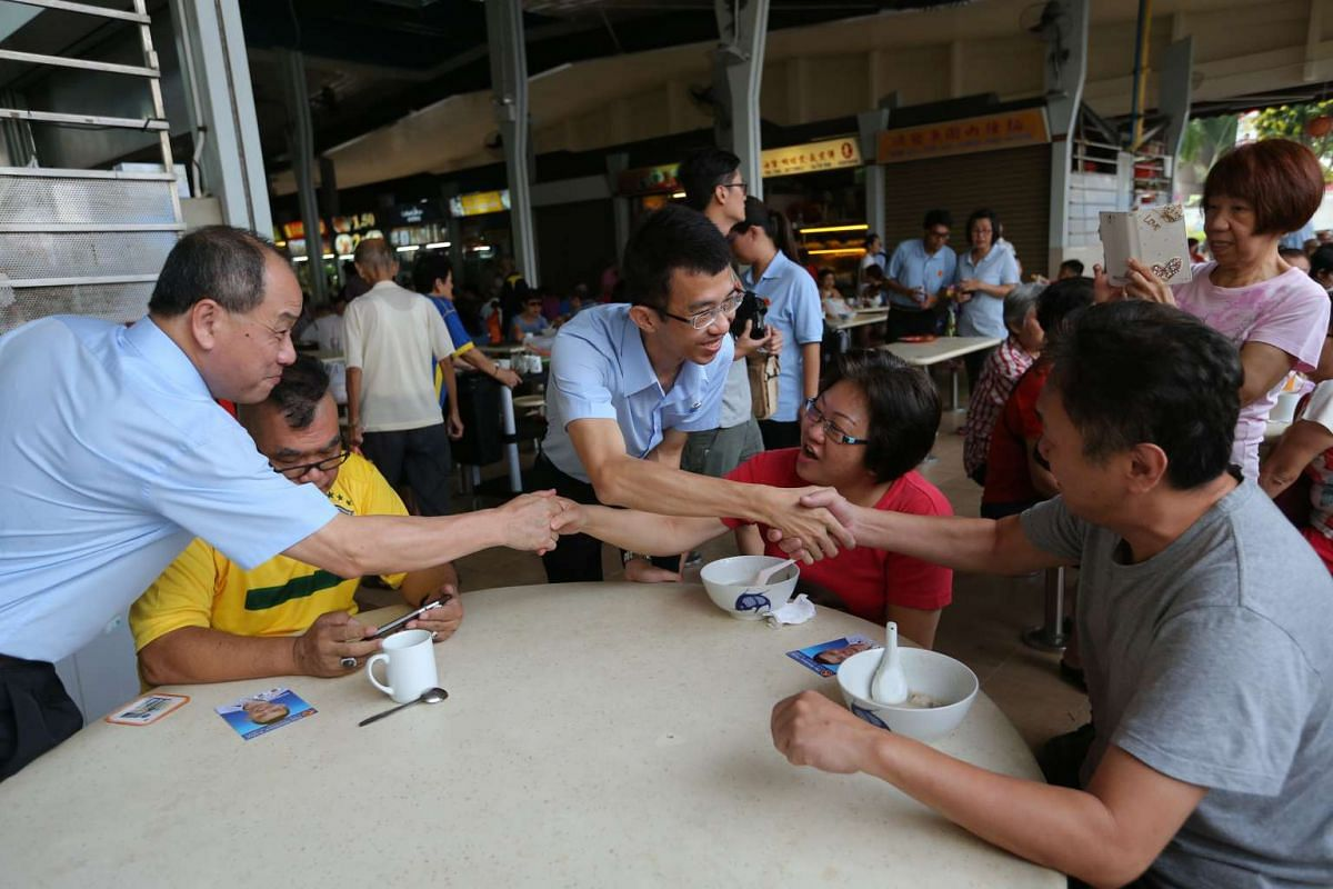 Workers' Party's Low Thia Khiang and Bernard Chen walkabout for MacPherson SMC outreach at Aljunied Blk 117 Market and Food Centre.