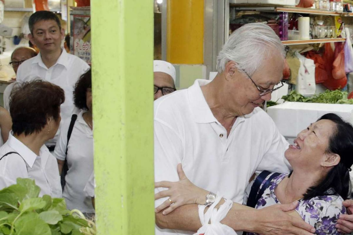 Madam Chu Eng Lan, a resident from Ubi, embraces PAP Marine Parade GRC candidate Emeritus Senior Minister Goh Chok Tong during his walkabout with fellow candidate Dr Fatimah Lateef at Eunos Crescent Market and Food Centre on Sept 5, 2015.