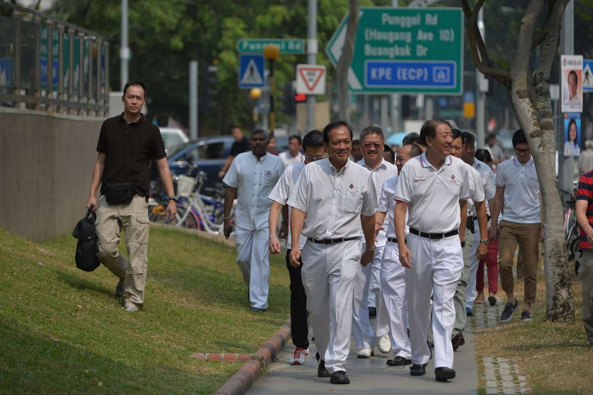 DPM Teo Chee Hean (front, right) and Punggol East SMC candidate Charles Chong (front, left) walking to Rivervale Plaza with other PAP members on Sept 6, 2015.