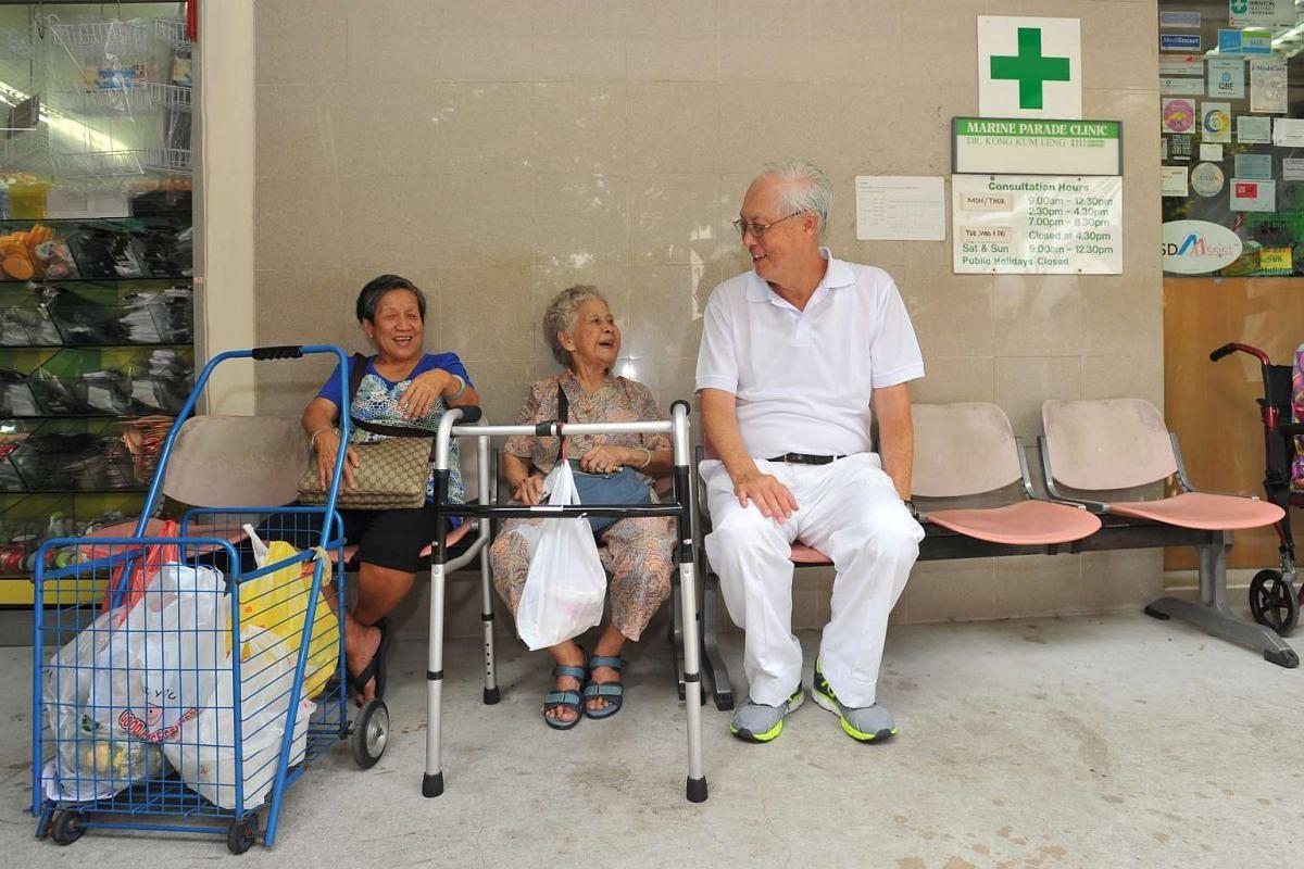 ESM Goh Chok Tong with Madam Tan Cheng Siew (left), 68, and Madam Ong Kim Phong, 89, at Marine Crescent on Sept 6, 2015.
