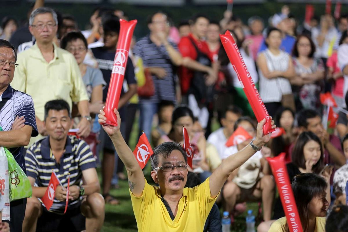 A supporter cheering during the Singapore Democratic Party (SDP) rally for Yuhua SMC electoral division at Jurong East Stadium.