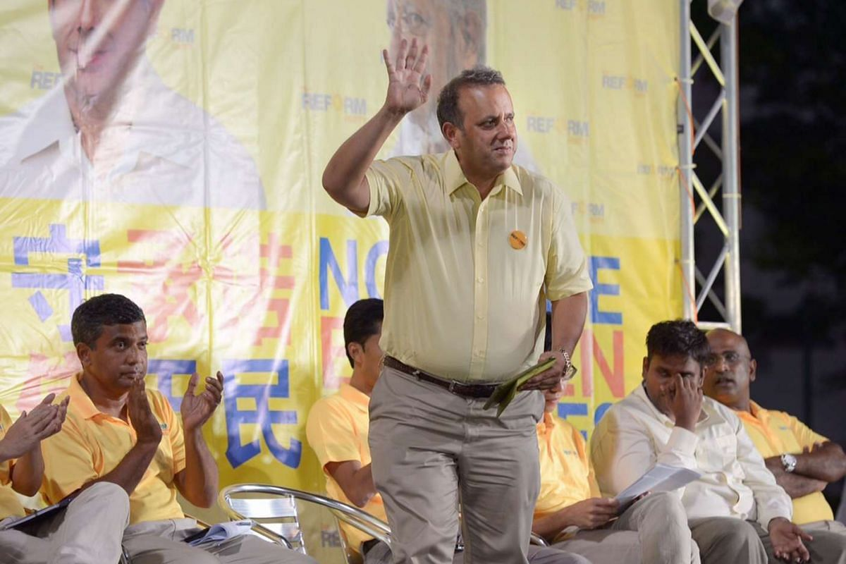Reform Party secretary-general Kenneth Jeyaretnam on stage at his party's rally at Delta Hockey Pitch.