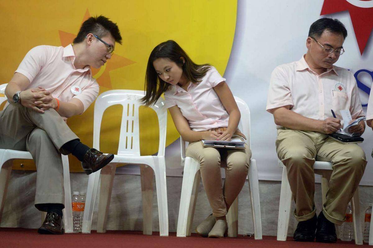 The NSP's Spencer Ng talking to Kevryn Lim during a rally for Sembawang GRC at Woodlands Drive 75.