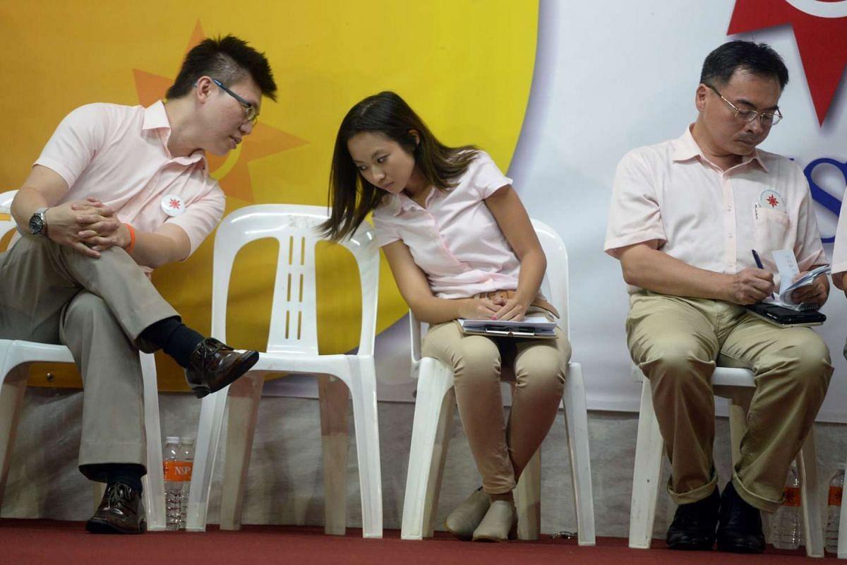 The NSP's Spencer Ng talking to Kevryn Lim during a rally for Sembawang GRC at Woodlands Drive 75.