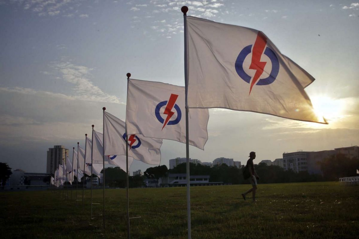 An attendee arriving for the PAP's Fengshan SMC election rally at Bedok North Avenue 4.