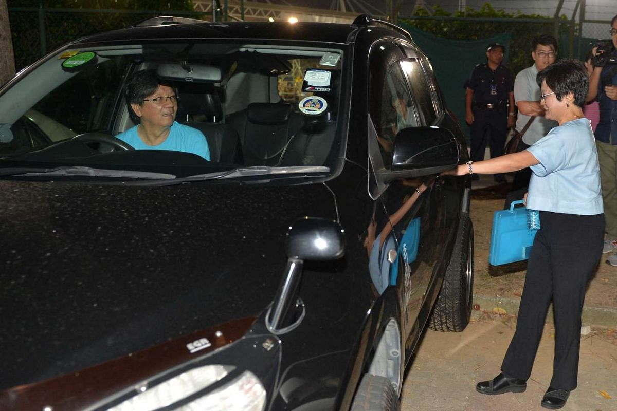 Workers' Party chairman Sylvia Lim entering her boyfriend Quah Kim Song's car after a rally at Yishun Stadium.