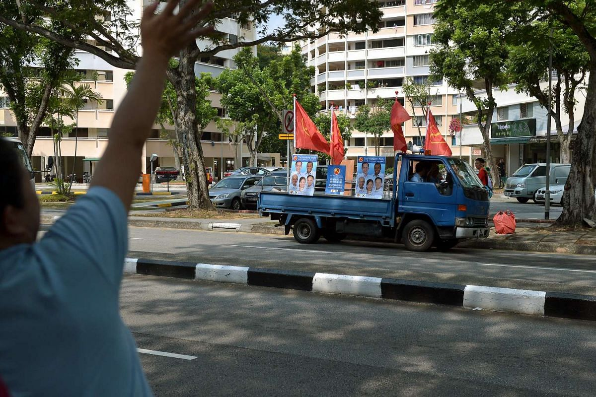 Worker's Party members waving to party trucks at Serangoon Ave 3.