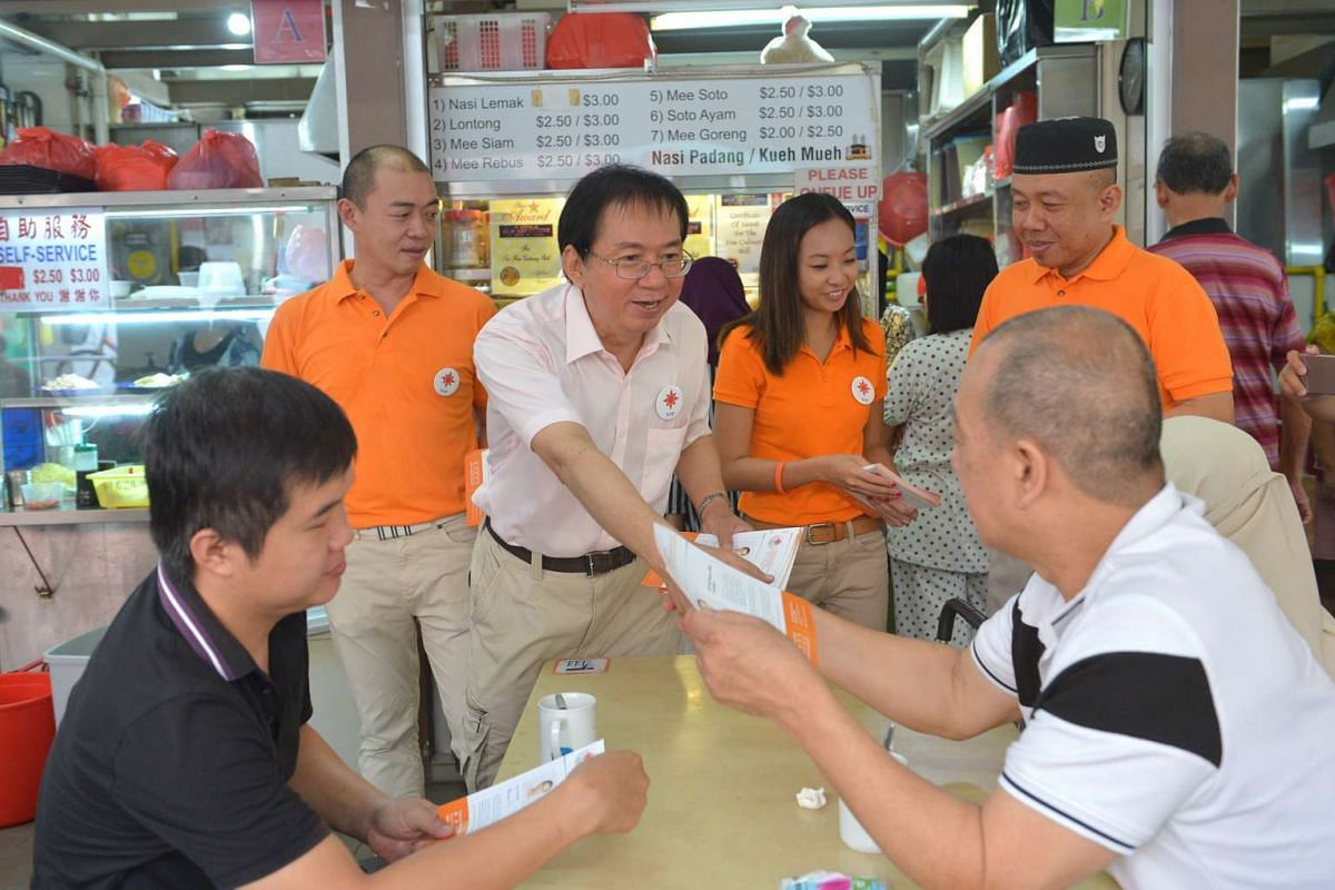 NSP MacPherson SMC candidate Cheo Chai Chen (in pink) during a walkabout at Pipit Road.