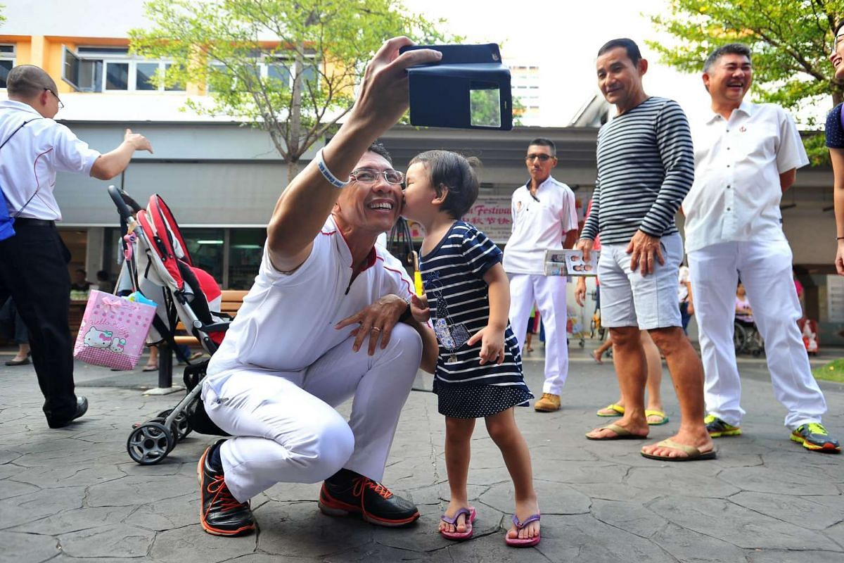 Two-year-old Ng Kai Xuan giving Dr Maliki Osman a kiss on the cheek during the PAP East Coast GRC team's walkabout at New Upper Changi Road.