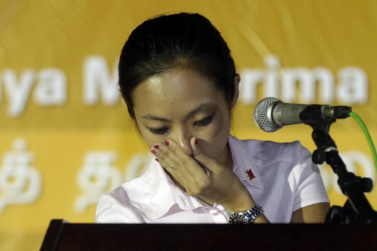 National Solidarity Party candidate for Sembawang GRC Kevryn Lim tearing up while speaking about issues regarding single mothers during an election rally at an open field along Circuit Road on Sept 7, 2015.