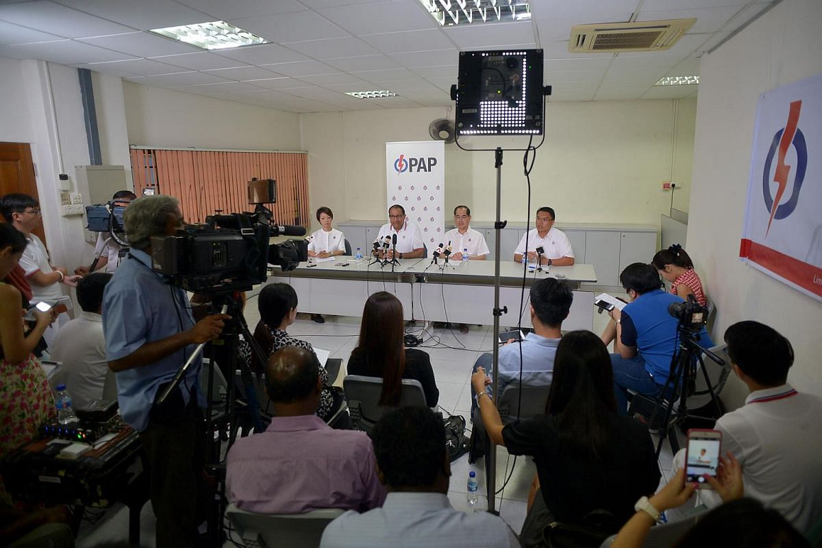 The People's Action Party's West Coast GRC team at a press conference: (from left) Ms Foo Mee Har, Mr S. Iswaran, Mr Lim Hng Kiang and Mr Patrick Tay.