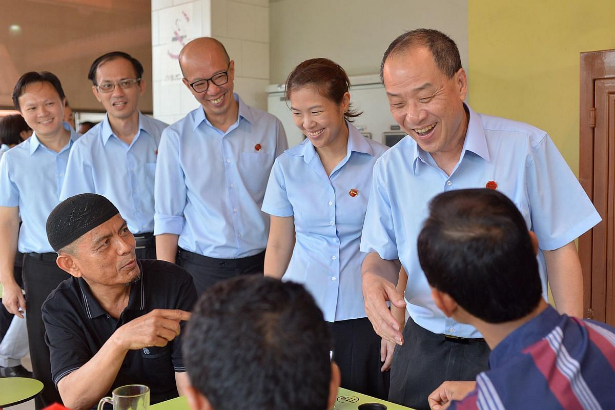 Mr Low Thia Kiang (right), secretary-general of the Workers' Party, with Marine Parade GRC candidates (from left) Dylan Ng, Yee Jenn Jong, Terence Tan and He Ting Ru, speaking to residents.