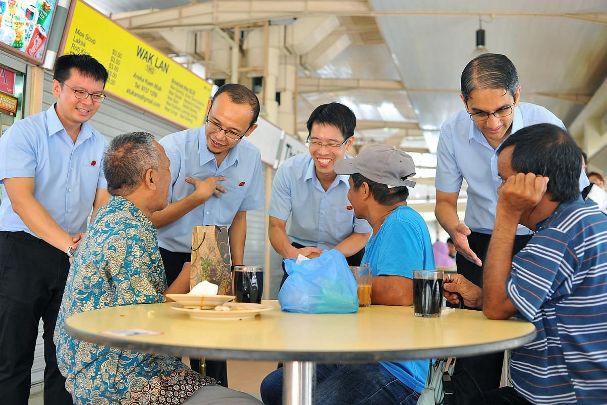 (From left) Workers' Party East Coast GRC candidates Daniel Goh, Mohamed Fairoz Shariff, Gerald Giam and Leon Perera visiting the Bedok North Street 1 Market and Food Centre on Sept 7, 2015.