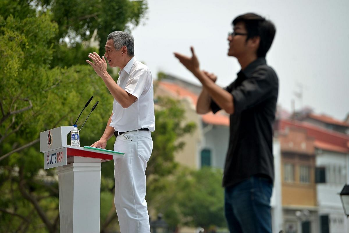 PM Lee Hsien Loong speaking during the lunchtime PAP rally at the Promenade area beside UOB Plaza on Sept 8, 2015.
