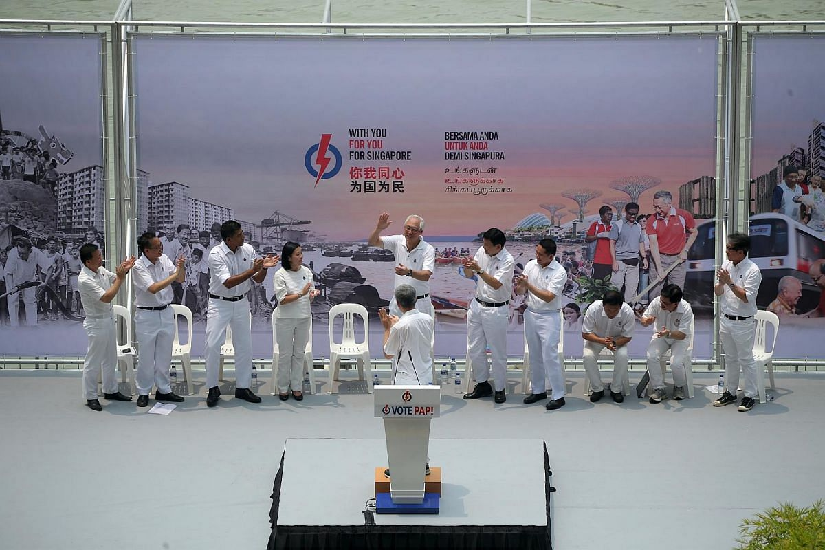 PAP candidates applauding Emeritus Senior Minister Goh Chok Tong at the PAP rally at the Promenade area beside UOB Plaza on Sept 8, 2015.