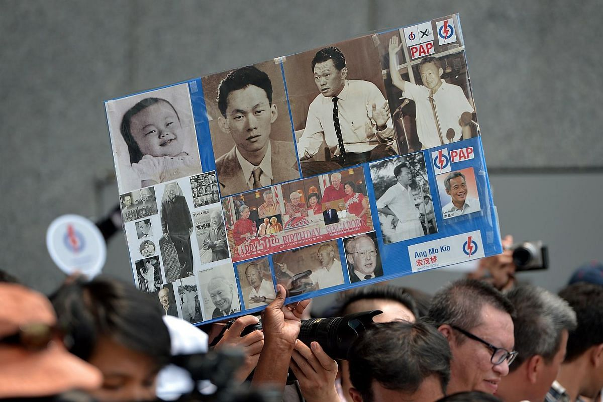 A sign in the crowd at the People's Action Party lunchtime rally at UOB Plaza, Singapore, on Sept 8, 2015.