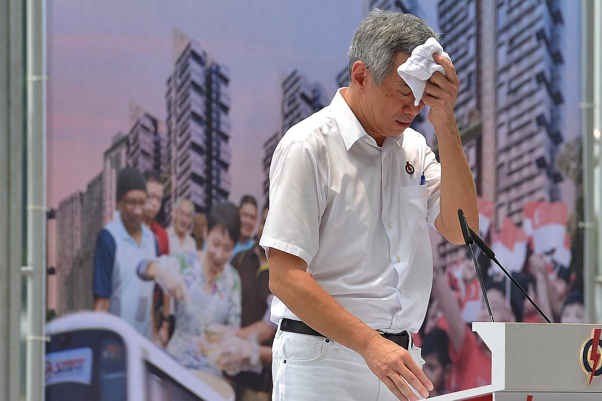 PM Lee Hsien Loong taking a break from his speech at the PAP rally at the Promenade area beside UOB Plaza on Sept 8, 2015.