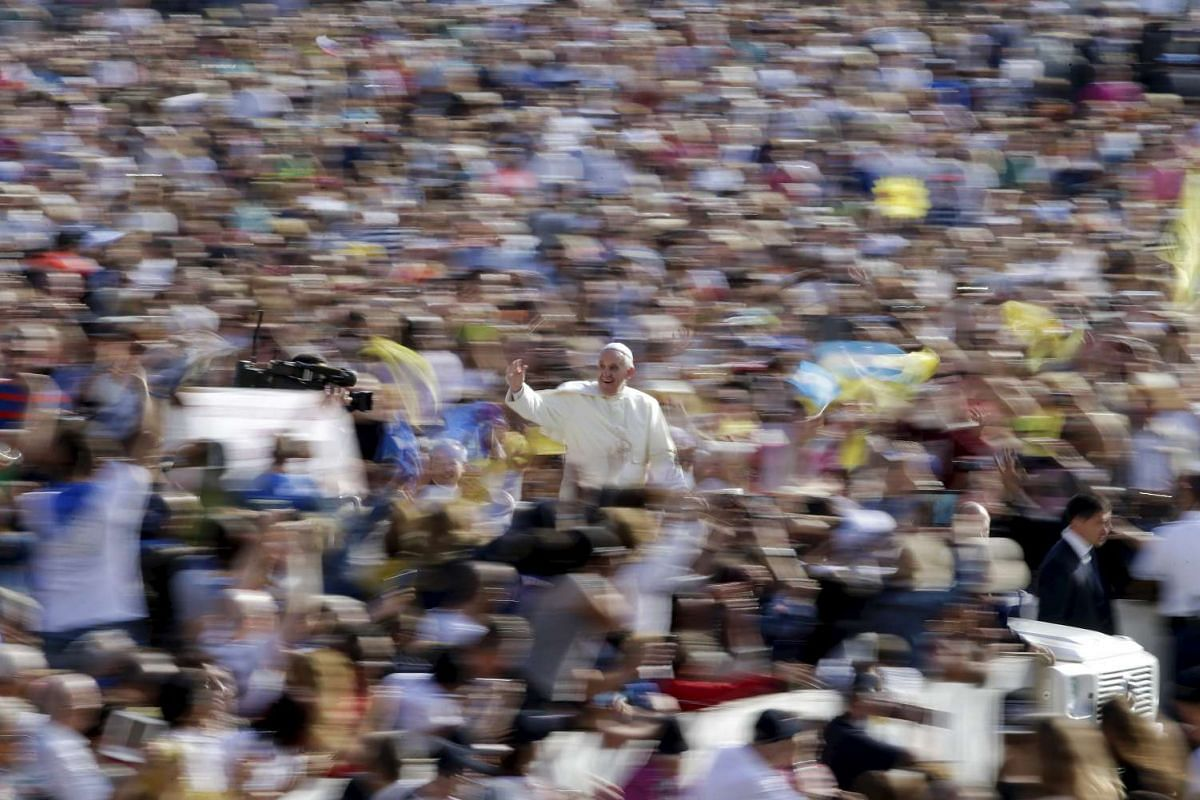 Pope Francis waving as he arrives to lead his general audience in Saint Peter's Square at the Vatican on Sept 9, 2015. PHOTO: REUTERS/MAX ROSSI