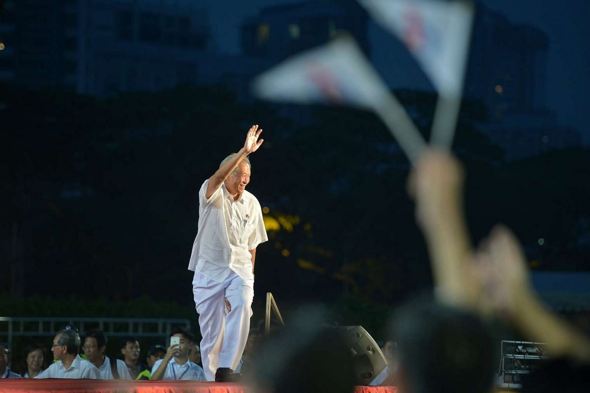 Mr Ng Eng Hen waving to the crowd as he steps up on stage at the PAP rally for Bishan-Toa Payoh GRC on Sept 8, 2015 held at the Toa Payoh Stadium.