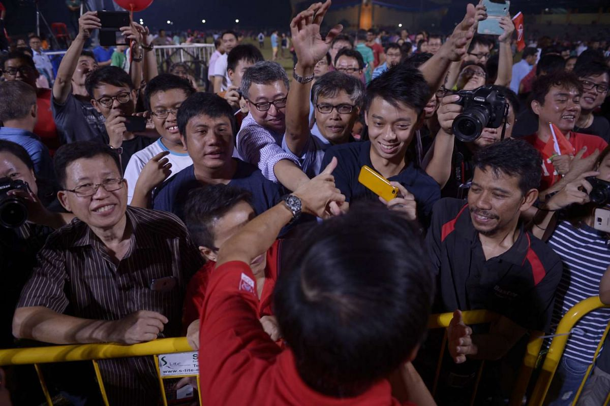Supporters of the Singapore Democratic Party (SDP) greeting Dr Chee Soon Juan after the rally at Woodlands Stadium.