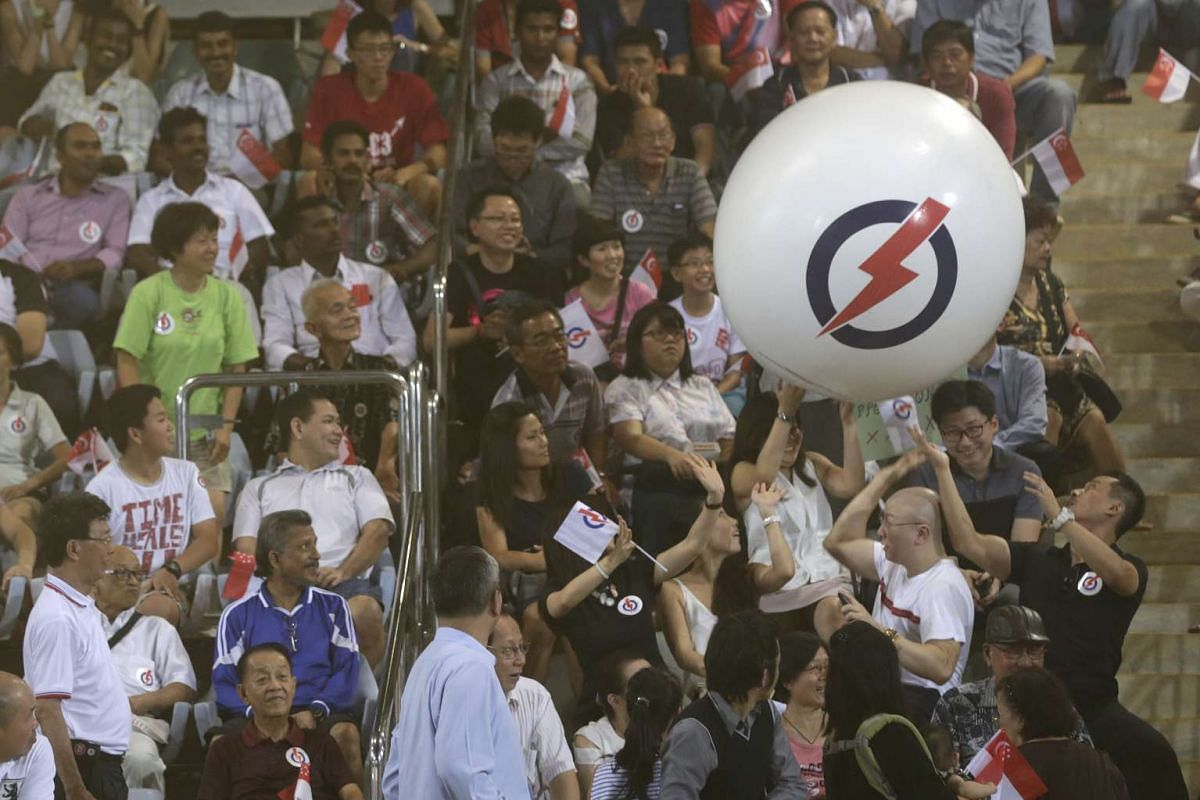 Rallygoers playing with a inflated ball before PAP Nee Soon GRC election rally at Yishun Stadium on Sept 8, 2015.