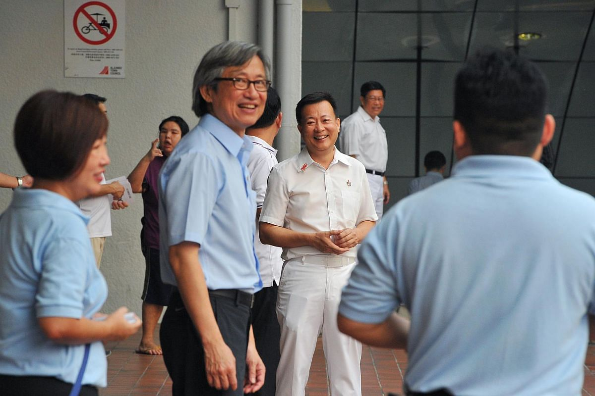 WP Aljunied GRC candidate Chen Show Mao (second from left) and PAP Aljunied GRC candidate Victor Lye (third from left) greeting residents outside Heartland Mall on Sept 8, 2015.