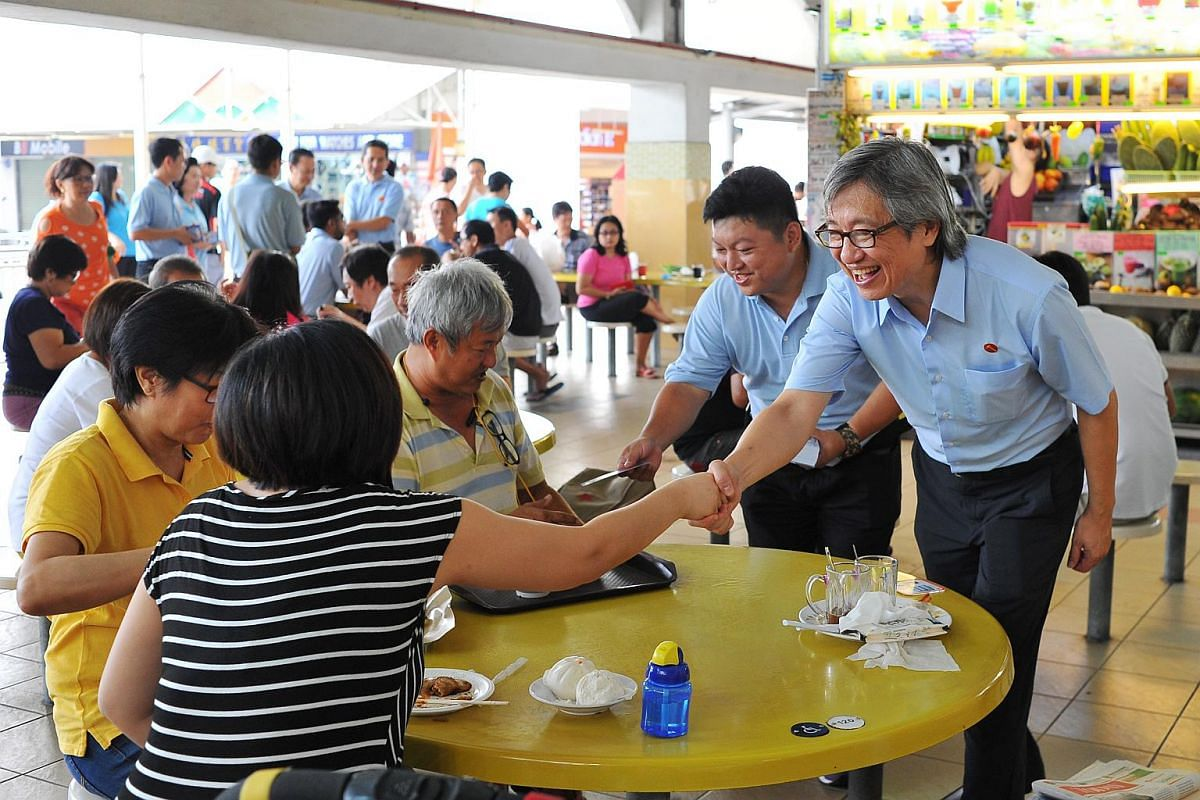 WP Aljunied GRC candidate Chen Show Mao (right) greeting residents of Aljunied GRC at Kovan Hougang Market & Food Centre on Sept 8, 2015.