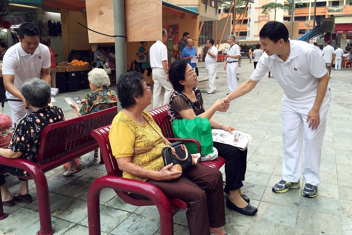 Mr Chee Hong Tat (right), PAP's candidate for Bishan-Toa Payoh GRC, greeting residents outside the market and food centre at Block 127 Toa Payoh Lorong 1 on Sept 8, 2015.
