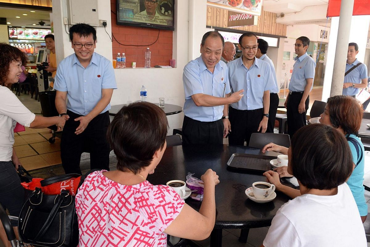 Low Thia Kiang (centre), secretary-general of Workers' Party with East Coast GRC candidates (from left) Daniel Goh, Mohamed Fairoz and Leon Perera chatting with diners during their walkabout at Simei coffeeshop on Sept 8, 2015.