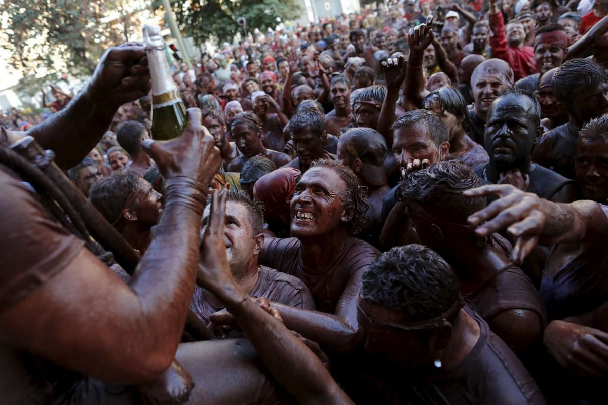 Revellers covered in paint taking part in the annual Cascamorras festival in Guadix, southern Spain, on Sept 9, 2015. PHOTO: REUTERS/MARCELO DEL POZO