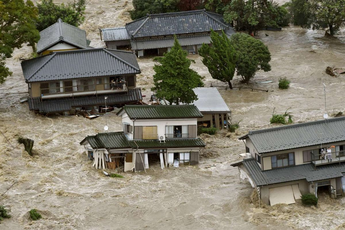 Residents waiting to be rescued by helicopters at a residential area flooded by the Kinugawa river, caused by typhoon Etau, in Joso, Ibaraki prefecture, Japan, on Sept 10, 2015. PHOTO: REUTERS/KYODO