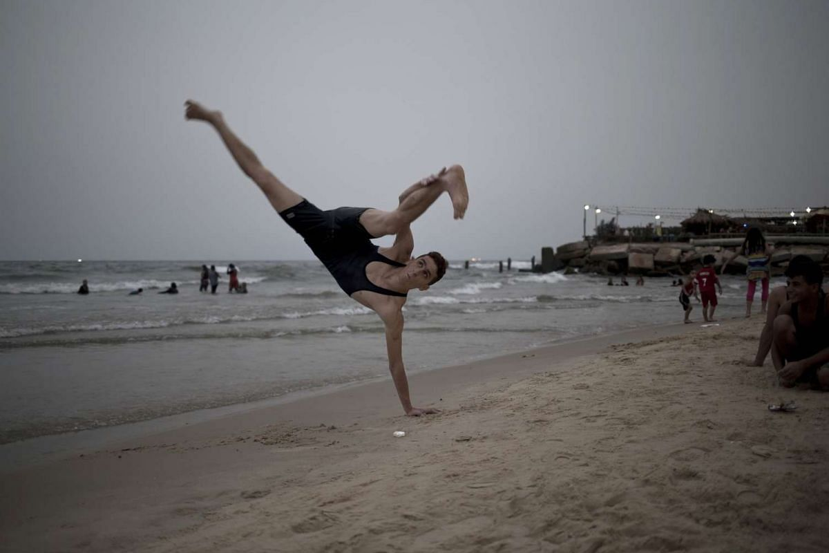 A Palestinian youth training on the beach on the Mediterranean Sea during a sandstorm in Gaza City on Sept 9, 2015. PHOTO: AFP/MOHAMMED ABED
