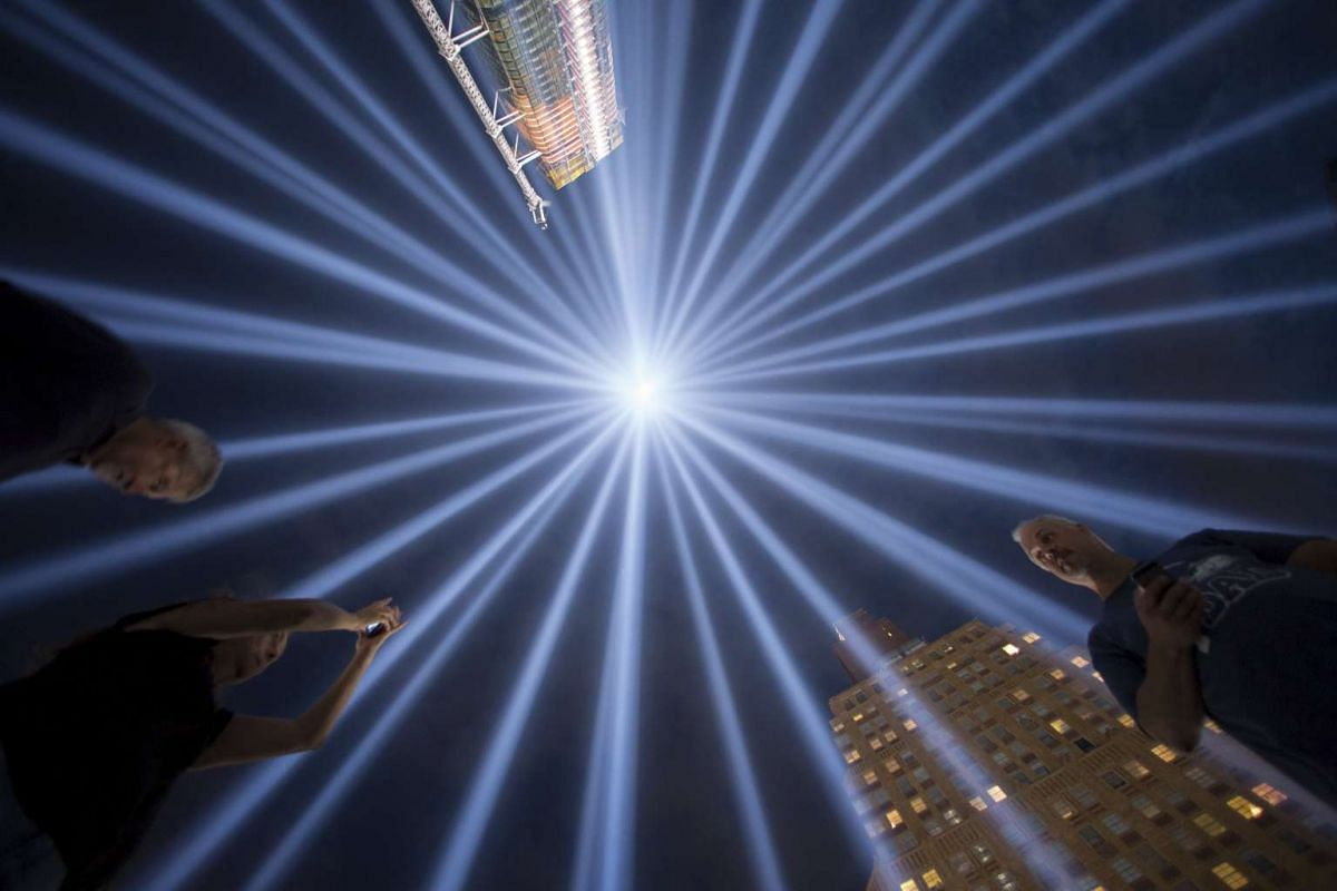 People gathering at Tribute In Light in Lower Manhattan, New York, on Sept 9, 2015. The tribute was lit two days ahead of the 14th anniversary of the 9/11 terrorist attacks. PHOTO: REUTERS/ANDREW KELLY
