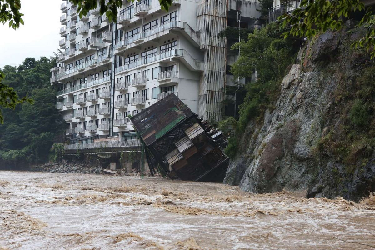 A hotel building falling into the floodwaters at Nikko mountain resort in Tochigi prefecture, north of Tokyo, on Sept 10, 2015.