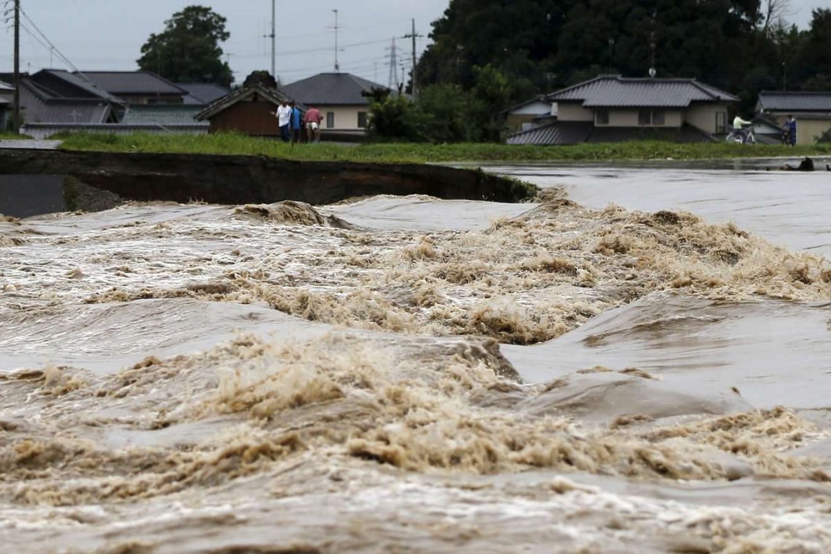 Floodwaters caused by Typhoon Etau surge in the Kinugawa river at a residential area in Joso, Ibaraki prefecture, Japan, on Sept 10, 2015.