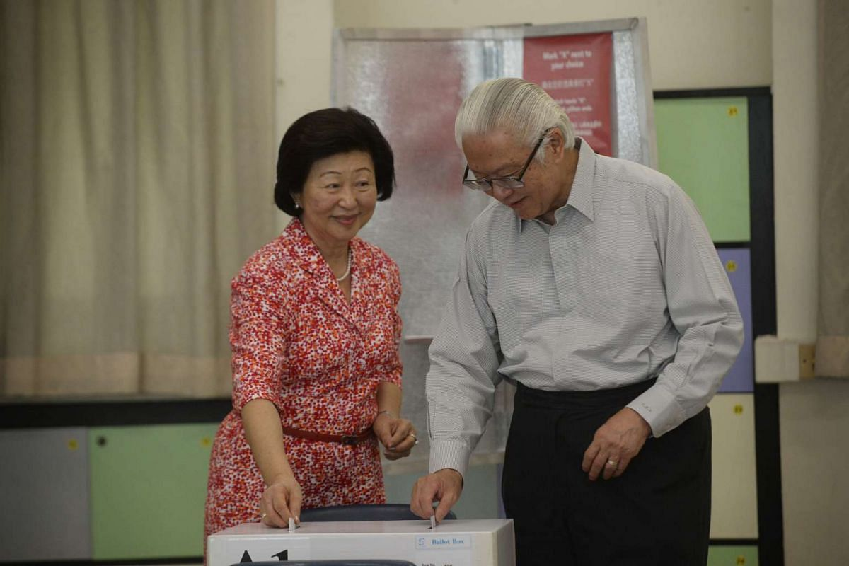 President Tony Tan and his wife, Mary, cast their vote at Nanyang Girls' High School.