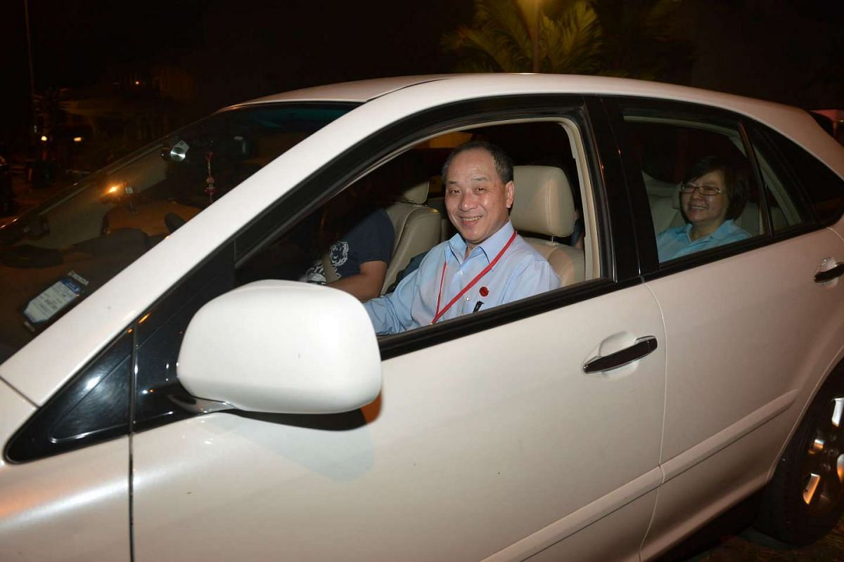 Workers' Party chief Low Thia Kiang leaving his home on Polling Day.
