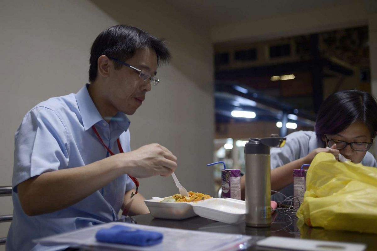 Workers' Party candidate for East Coast GRC Gerald Giam having his dinner at a void deck in Simei Street 1 after delivering food to polling agents at a nearby polling station.