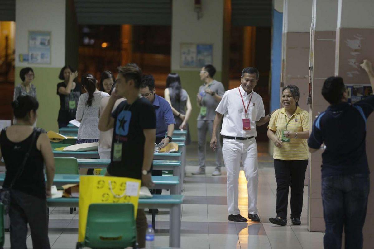 People's Action Party candidate for Holland-Bukit Timah GRC Dr Vivian Balakrishnan at Bukit Panjang Primary School as polling closes at 8pm.