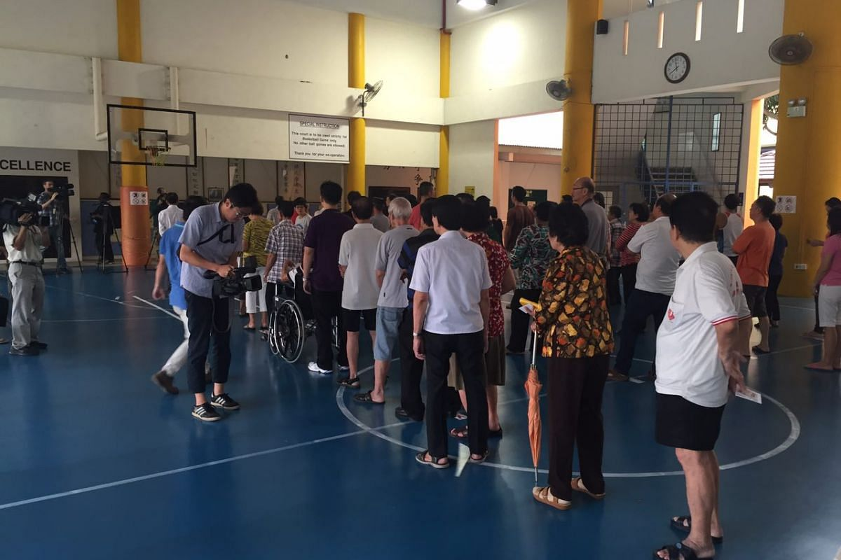 Voters queueing at the polling station at Pei Chun Public School.
