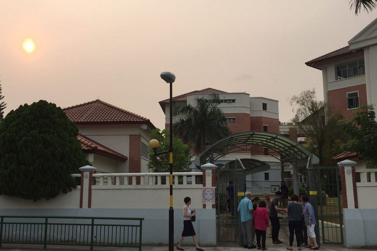 Singaporeans streaming into Nanyang Girls' High School to cast their votes.