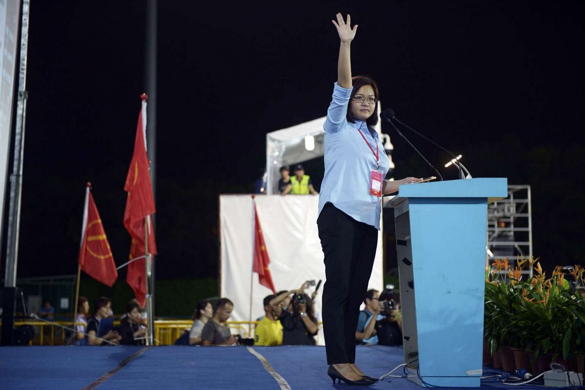 Workers' Party candidate Lee Li Lian waving to supporters before her concession speech at Hougang Stadium. She lost Punggol East SMC to PAP's Charles Chong, who took 51.8 per cent of the votes.