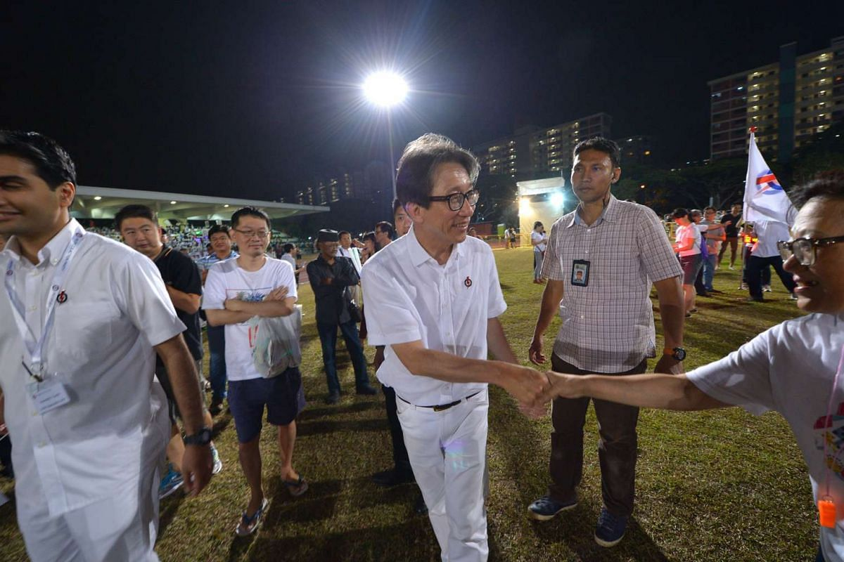 Manpower Minister Lim Swee Say, who is the anchor minister for East Coast GRC, arrives at Bedok Stadium to await the results of the polls.