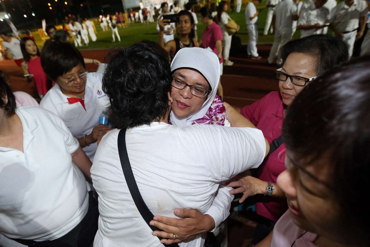 Supporters console Madam Halimah Yacob, the PAP candidate for Marsiling-Yew Tee. Her mother, who had been hospitalised, died on the morning of Polling Day.