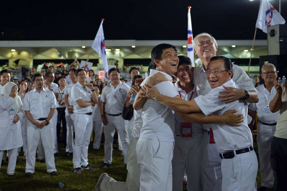 The PAP team for Marine Parade GRC (from left) Mr Tan Chuan-Jin, Mr Edwin Tong (hidden), Ms Fatimah Lateef, ESM Goh Chok Tong and Mr Seah Kian Peng reacting to  the result. The team won 64.1 per cent of the votes cast in the GRC, beating their WP cha