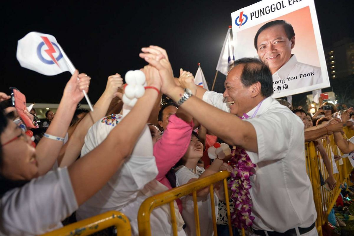 PAP candidate Charles Chong at Bedok Stadium. He wrested back Punggol East SMC from the Workers' Party's Lee Li Lian with 51.8 per cent of the votes.